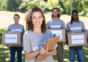 Happy volunteers in the park