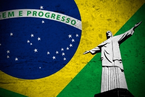Close view of a grunge illustration of the brazilian flag with the Christ the Redeemer printed.